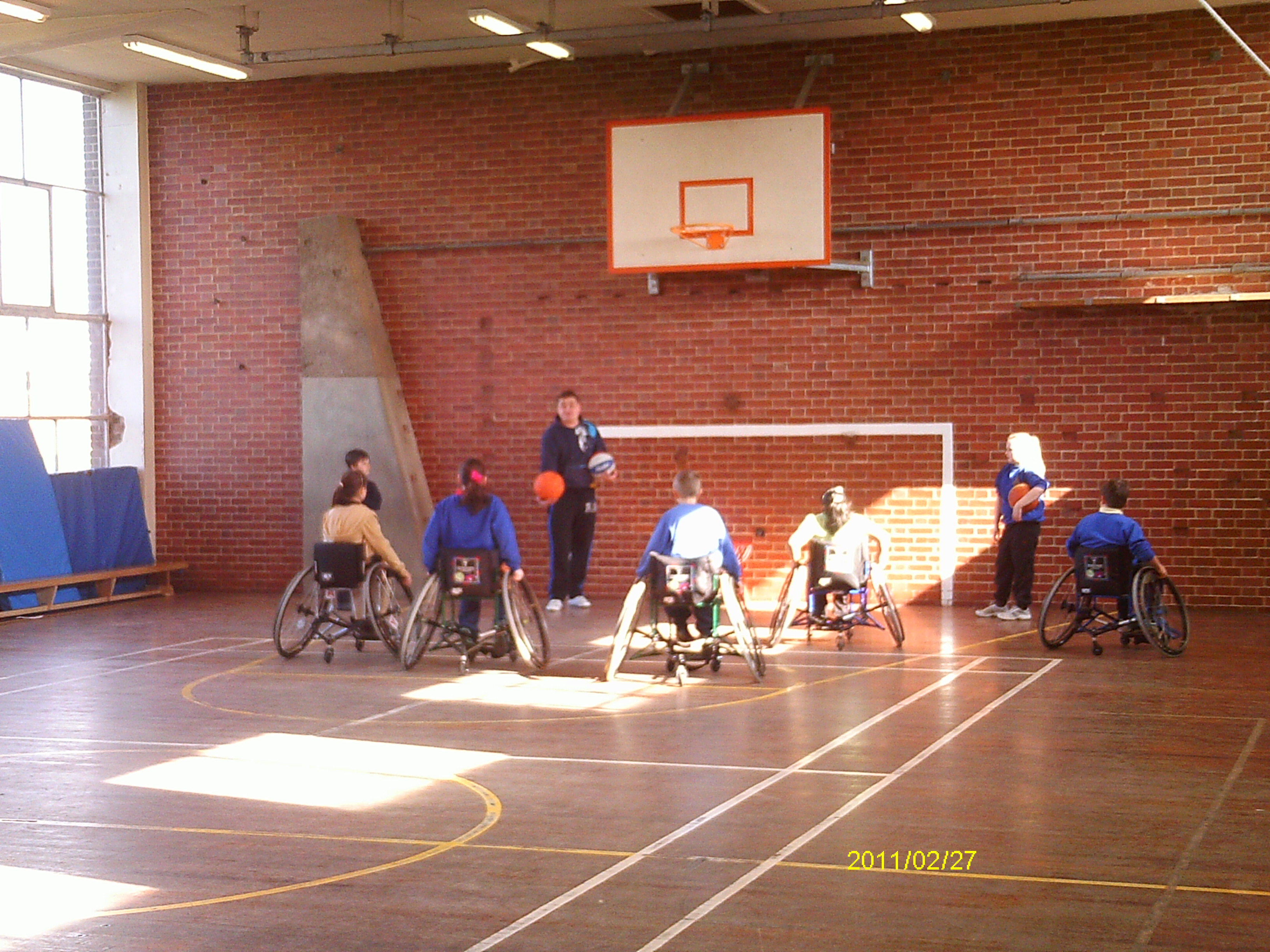 A typical outreach session showing the ropes of basketball and also educating on disability